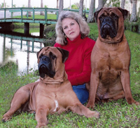 Reba and her dogs that were suffering from mange